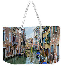 Weekender Tote Bag featuring the photograph Gondolier On Canal Venice Italy by Nathan Bush