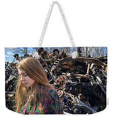 Weekender Tote Bag featuring the photograph Pieces And Parts by Carl Young
