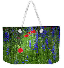 Weekender Tote Bag featuring the photograph Poppies And Wildflowers by Mark Duehmig