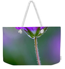 Weekender Tote Bag featuring the photograph Purple Flower by John Rodrigues