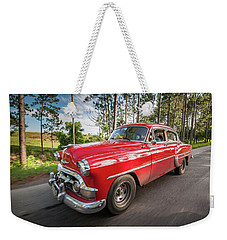 Weekender Tote Bag featuring the photograph Red Classic Cuban Car by Mark Duehmig