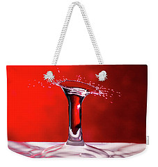 Weekender Tote Bag featuring the photograph Red Column Water Drop Collision by SR Green