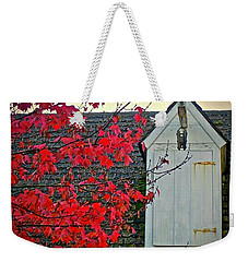 Weekender Tote Bag featuring the photograph Red... by Don Moore