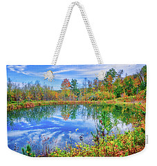 Weekender Tote Bag featuring the photograph Reflecting On Fall At The Pond by Lynn Bauer