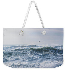 Weekender Tote Bag featuring the photograph Reynisfjara Seagull Over Crashing Waves by Nathan Bush