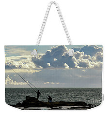 Weekender Tote Bag featuring the photograph Rock Fishing by Pablo Avanzini