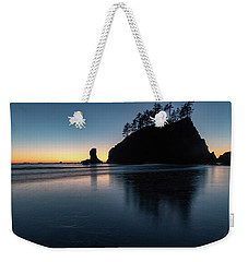 Weekender Tote Bag featuring the photograph Sea Stack Silhouette by Ed Clark