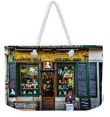 Weekender Tote Bag featuring the photograph Shakespeare And Company Bookstore by Craig J Satterlee