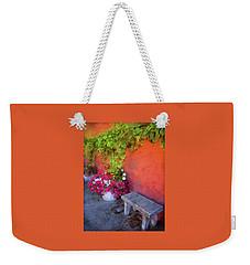 Weekender Tote Bag featuring the photograph Sidewalk Floral In Brownsville by Thom Zehrfeld