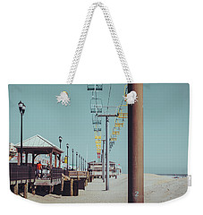 Weekender Tote Bag featuring the photograph Sky Ride by Steve Stanger