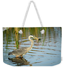 Weekender Tote Bag featuring the photograph Snack Time For Blue Heron by Donald Brown