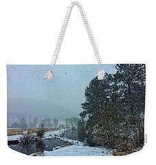 Weekender Tote Bag featuring the photograph Snowstorm At The Lake by Dan Miller