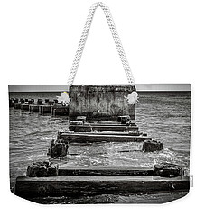 Weekender Tote Bag featuring the photograph Something In The Water by Steve Stanger