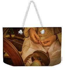 Weekender Tote Bag featuring the photograph Spinner by Guy Whiteley