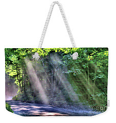 Weekender Tote Bag featuring the photograph Sun Streaks by Debbie Stahre