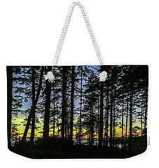 Weekender Tote Bag featuring the photograph Sunset Thru The Trees by Ed Clark