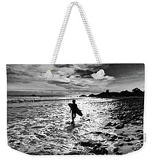 Weekender Tote Bag featuring the photograph Surfer Silhouette by John Rodrigues