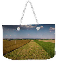 Weekender Tote Bag featuring the photograph The Colored Fields by Okan YILMAZ