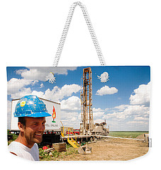 Weekender Tote Bag featuring the photograph The Gas Man by Carl Young