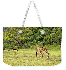 Weekender Tote Bag featuring the photograph The Giraffe And The Cape Buffalo by Kay Brewer