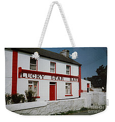 Weekender Tote Bag featuring the painting The Lucky Star Bar, Kilronan, Aran by Val Byrne