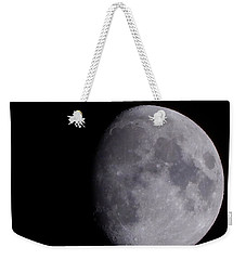 Weekender Tote Bag featuring the photograph The Moon by Lukas Miller