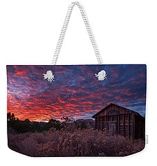 Weekender Tote Bag featuring the photograph The Perfect Sunset by Edgars Erglis