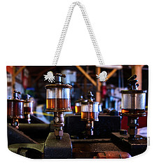 Weekender Tote Bag featuring the photograph The Power Of Oil by Mark Dodd