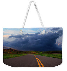 Weekender Tote Bag featuring the photograph The Road by John Rodrigues
