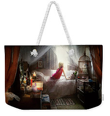 Weekender Tote Bag featuring the photograph The Sorcerer's Apprentice by Mike Savad - Abbie Shores
