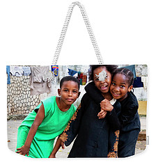 Weekender Tote Bag featuring the photograph The Zanzibar Girls by Kay Brewer