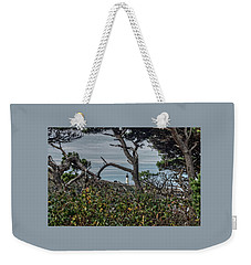 Weekender Tote Bag featuring the photograph Through The Foliage by Thom Zehrfeld