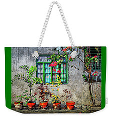 Weekender Tote Bag featuring the photograph Tropical Wall by Michael Arend