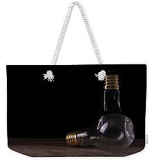 Two Light Bulbs Arranged On A Wooden Table  Weekender Tote Bag