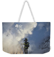 Weekender Tote Bag featuring the photograph Up In Smoke by Carl Young
