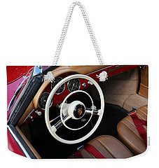 Weekender Tote Bag featuring the photograph Vintage Red Convertible Interior by Debi Dalio