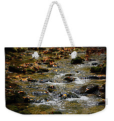 Weekender Tote Bag featuring the photograph Water Navigates The Rocks by Raymond Salani III