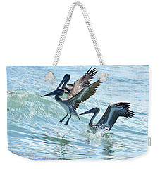 Wave Hopping Pelicans Weekender Tote Bag