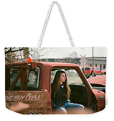 Weekender Tote Bag featuring the photograph We Buys Cars by Carl Young