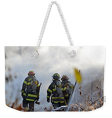 Weekender Tote Bag featuring the photograph We're Going In by Carl Young