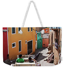 Weekender Tote Bag featuring the photograph Who Said Mexicans Were Poor by Tatiana Travelways