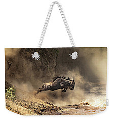Wildebeest Leaps From The Bank Of The Mara River Weekender Tote Bag