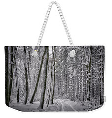 Weekender Tote Bag featuring the photograph Wintry Forest Track by Edmund Nagele