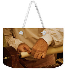 Weekender Tote Bag featuring the photograph Wood Lathe Operator by Guy Whiteley