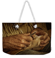 Weekender Tote Bag featuring the photograph Woodcarver by Guy Whiteley