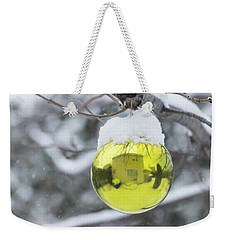 Weekender Tote Bag featuring the photograph Yellow Christmas Ball Outside, Covered By Snow And House Reflect by Cristina Stefan