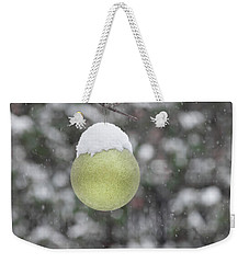 Weekender Tote Bag featuring the photograph Yellow Christmas Ball Outside, Covered By Snow. Outside Snowy Wi by Cristina Stefan