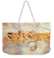 Weekender Tote Bag featuring the photograph Yesterday's Seeds by Randi Grace Nilsberg
