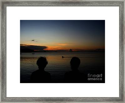 Enjoying Sunset Framed Print by Michelle Meenawong