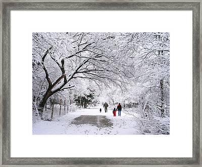 Family Walk In The Snow Framed Print